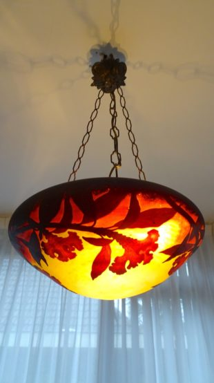 An Art Nouveau hanging lamp with etched glass